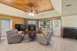 Living Room with Knotty Pine Paneling